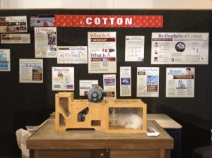 Cotton Booth with small cotton gin, was next to our booth at the rodeo
