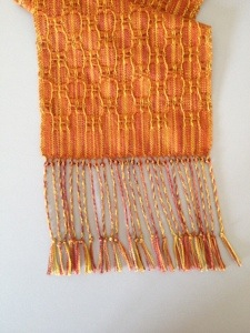 One bead on each group of twisted fringe. Position at lower edge of scarf.