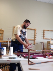 Michael Cook demonstrating  Tablet Weaving